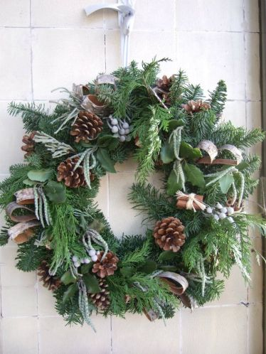 door wreath christmas wreath pine cones blue pine