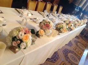 peach and cream top table arrangement