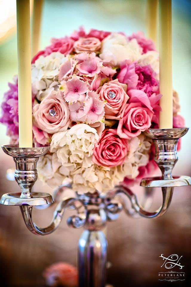 flower arrangement on candelabra by Your London Florist