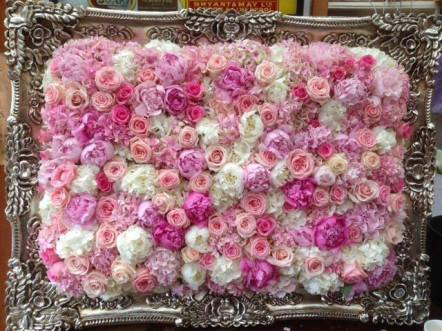 flower arrangement in the picture frame by Your London Florist