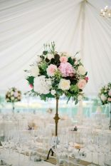 tall arrangements in marquee by Your London Florist
