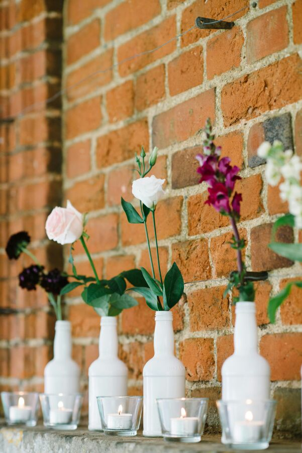 flowers in a bottle by Your London Florist