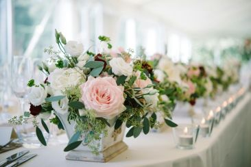 pink and cream flowers in urn by Your London Florist