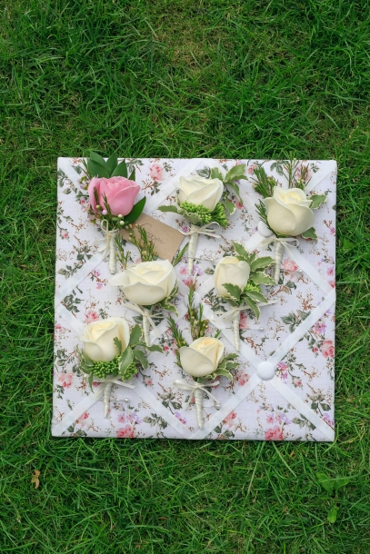 "Rose buttonholes by ""Your London Florist"""
