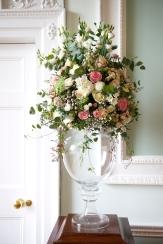 flower pedestal on a glass urn