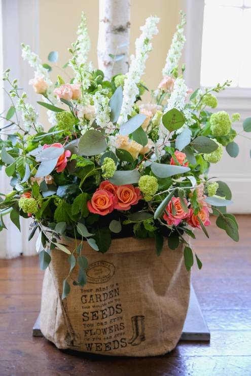 country style arrangement in jute bag