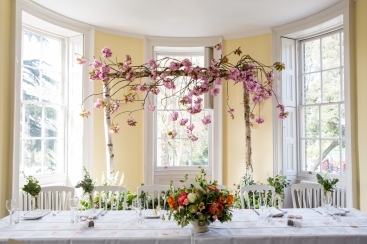cherry blossom arch registry table flowers